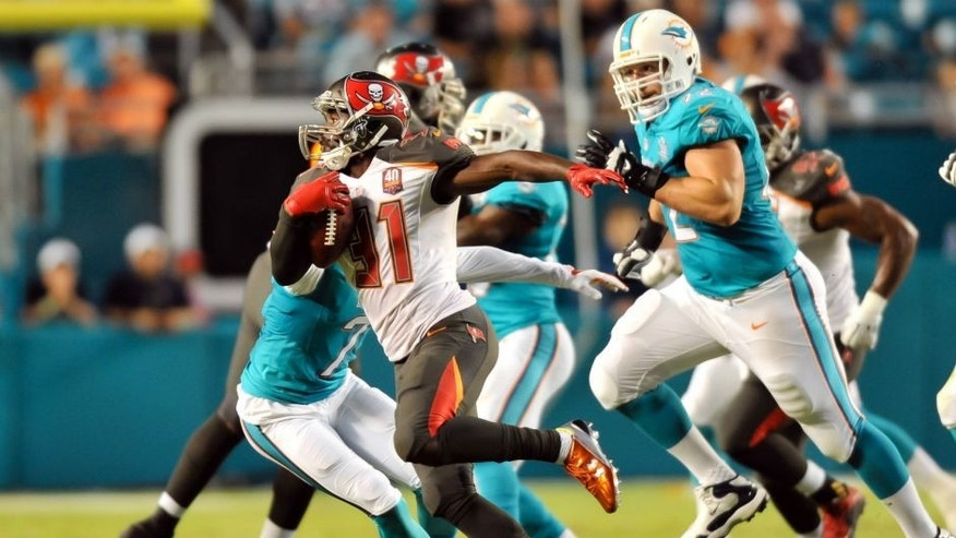 <p>Sep 3, 2015; Miami Gardens, FL, USA; Tampa Bay Buccaneers strong safety Major Wright (31) eludes the Miami Dolphins during the first half at Sun Life Stadium. Mandatory Credit: Steve Mitchell-USA TODAY Sports</p>