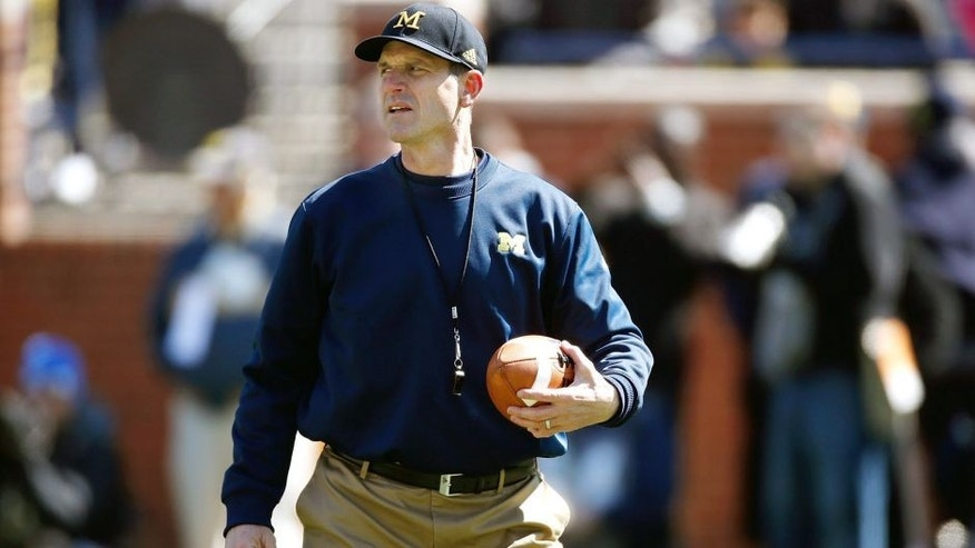 ANN ARBOR, MI - APRIL 04: Head coach Jim Harbaugh of the Michigan Wolverines looks on during the Michigan Football Spring Game on April 4, 2015 at Michigan Stadium in Ann Arbor, Michigan. (Photo by Gregory Shamus/Getty Images)