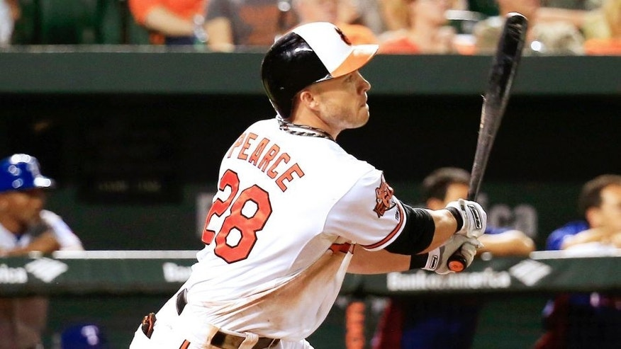 BALTIMORE, MD - JULY 03: Steve Pearce #28 of the Baltimore Orioles follows his RBI double against the Texas Rangers in the fifth inning at Oriole Park at Camden Yards on July 3, 2014 in Baltimore, Maryland. (Photo by Rob Carr/Getty Images)