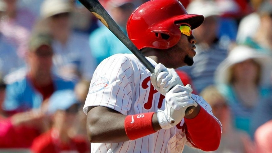 Mar 3, 2015; Clearwater, FL, USA; Philadelphia Phillies left fielder Domonic Brown (9) singles during the fourth inning against the New York Yankees during a spring training baseball game at Bright House Field. Mandatory Credit: Kim Klement-USA TODAY Sports