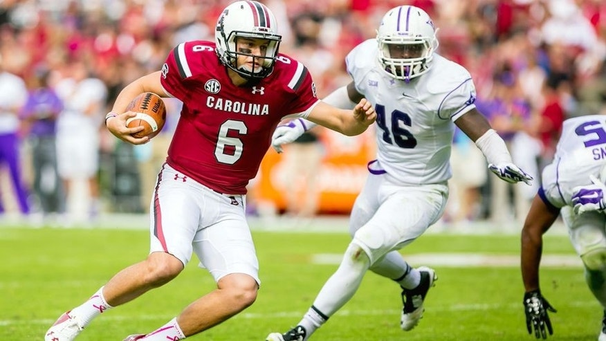 Oct 18, 2014; Columbia, SC, USA; South Carolina Gamecocks quarterback Connor Mitch (6) scrambles for yardage as Furman Paladins linebacker Cory Magwood (46) pursues in the second half at Williams-Brice Stadium. Mandatory Credit: Jeff Blake-USA TODAY Sports