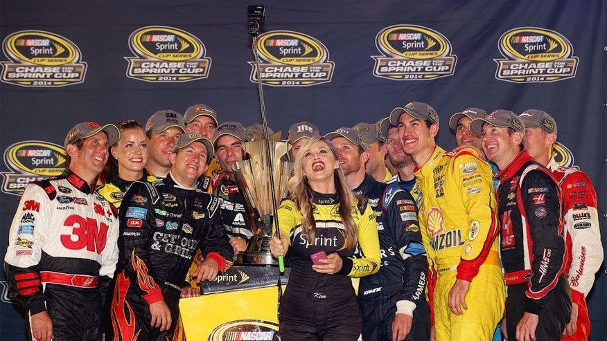 RICHMOND, VA - SEPTEMBER 06: Miss Sprint Cup Kim Coon takes a selfie with Chase for the Sprint Cup qualifiers Jeff Gordon, driver of the #24 Drive to End Hunger Chevrolet, Kyle Busch, driver of the #18 M&M's Toyota, Carl Edwards, driver of the #99 Kelloggs/Frosted Flakes Ford, Ryan Newman, driver of the #31 Catepillar Chevrolet, Miss Sprint Cup Madison Martin, Miss Sprint Cup Kim Coon, Dale Earnhardt Jr., driver of the #88 Nationwide Insurance Chevrolet, Matt Kenseth, driver of the #20 Dollar General Toyota, Aric Almirola, driver of the #43 Gwaltney Ford, Brad Keselowski, driver of the #2 Miller Lite Ford, Denny Hamlin, driver of the #11 FedEx Express Toyota, Greg Biffle, driver of the #16 3M Call Before You Dig Ford, AJ Allmendinger, driver of the #47 Bush's Beans Chevrolet, Kasey Kahne, driver of the #5 Farmers Insurance Chevrolet, Joey Logano, driver of the #22 Shell-Pennzoil Ford, Kurt Busch, driver of the #41 Haas Automation Chevrolet, and Kevin Harvick, driver of the #4 Budweiser Chevrolet, after qualifying for the Chase for the Sprint Cup during the NASCAR Sprint Cup Series Federated Auto Parts 400 at Richmond International Raceway on September 6, 2014 in Richmond, Virginia. (Photo by Chris Graythen/NASCAR via Getty Images)