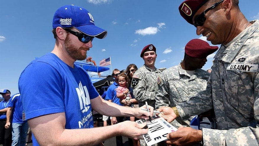 CHARLOTTE, NC - MAY 24: Dale Earnhardt Jr., driver of the #88 Nationwide Chevrolet, signs autographs for U.S. Army members prior to the NASCAR Sprint Cup Series Coca-Cola 600 at Charlotte Motor Speedway on May 24, 2015 in Charlotte, North Carolina. (Photo by Rainier Ehrhardt/Getty Images)