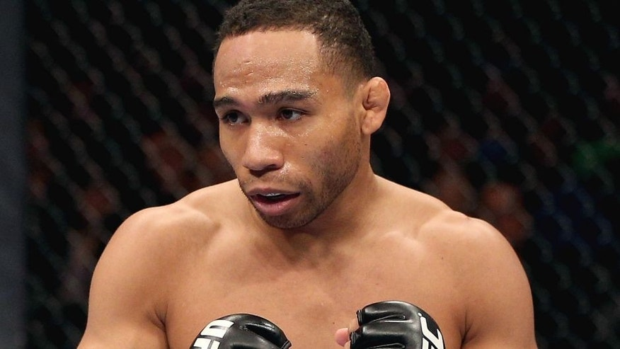 MINNEAPOLIS, MN - OCTOBER 05: John Dodson stands in the Octagon during his flyweight fight against Jussier Formiga at the UFC on FX event at Target Center on October 5, 2012 in Minneapolis, Minnesota. (Photo by Josh Hedges/Zuffa LLC/Zuffa LLC via Getty Images)