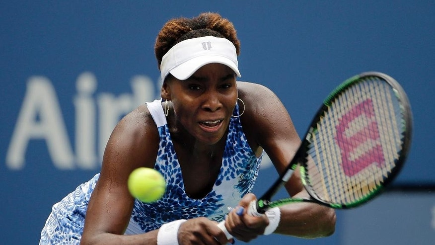 Venus Williams, of the United States, returns a shot to Belinda Bencic, of Switzerland, during the third round of the U.S. Open tennis tournament, Friday, Sept. 4, 2015, in New York. (AP Photo/Matt Rourke)