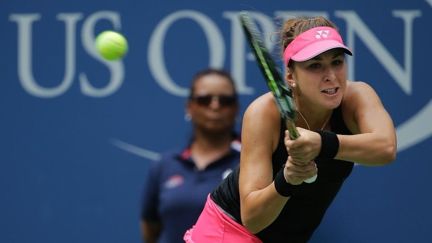 Belinda Bencic, of Switzerland, returns a shot to Venus Williams, of the United States, during the third round of the U.S. Open tennis tournament, Friday, Sept. 4, 2015, in New York. (AP Photo/Matt Rourke)