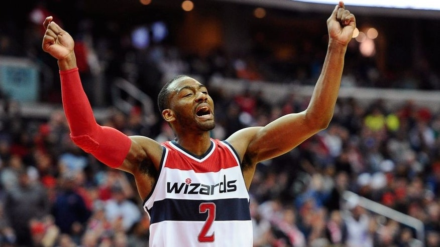 Mar 14, 2015; Washington, DC, USA; Washington Wizards guard John Wall (2) celebrates against the Sacramento Kings during the fourth quarter at Verizon Center. Mandatory Credit: Brad Mills-USA TODAY Sports