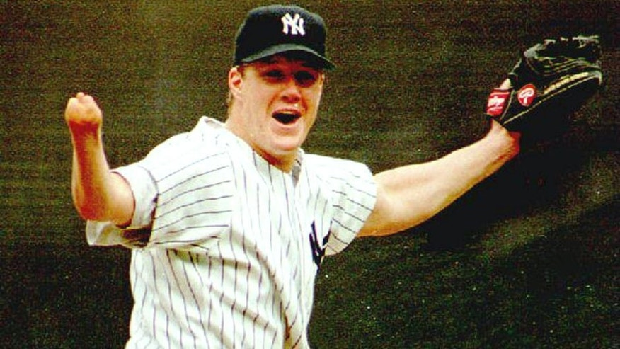NEW YORK, NY - SEPTEMBER 4: New York Yankees pitcher Jim Abbott celebrates after the last out of New York's first no-hitter in 10 years 04 September 1993. Abbott, who was born without a right hand, walked five and struck out three as the Yankees defeated the Cleveland Indians 4-0. (Photo credit should read MARK D. PHILLIPS/AFP/Getty Images)