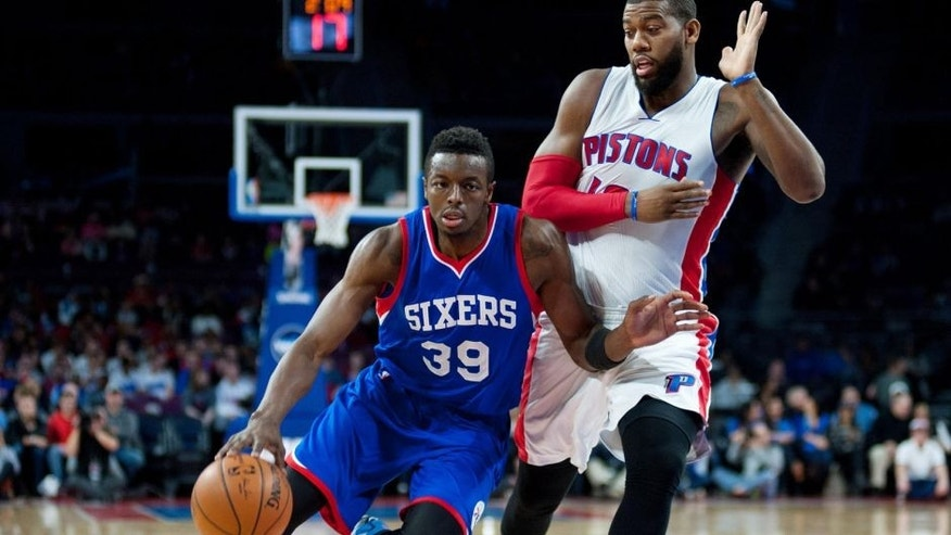 Dec 6, 2014; Auburn Hills, MI, USA; Philadelphia 76ers forward Jerami Grant (39) drives past Detroit Pistons forward Greg Monroe (10) during the first quarter at The Palace of Auburn Hills. Mandatory Credit: Tim Fuller-USA TODAY Sports