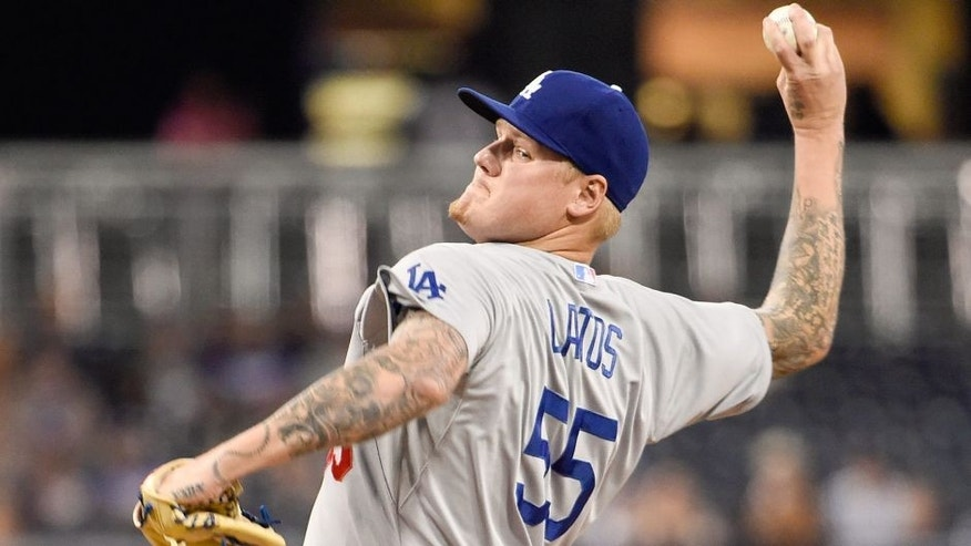 SAN DIEGO, CA - SEPTEMBER 3: Mat Latos #55 of the Los Angeles Dodgers pitches during the first inning of a baseball game against the San Diego Padres at Petco Park September, 3, 2015 in San Diego, California. (Photo by Denis Poroy/Getty Images)