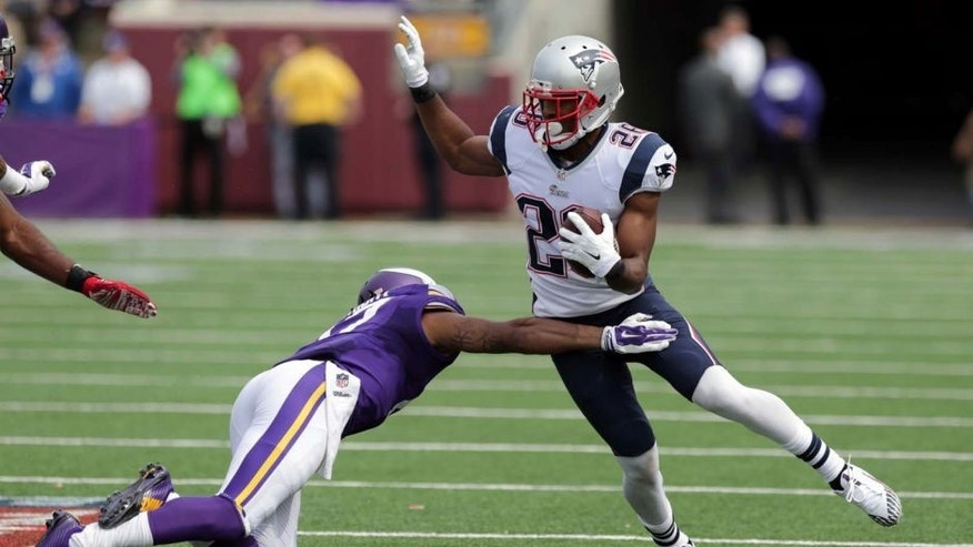 New England Patriots cornerback Logan Ryan (right) tries to avoid Minnesota Vikings wide receiver Jarius Wright after intercepting a pass during the third quarter.