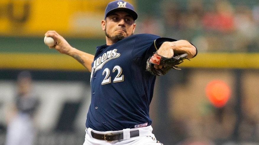 <p>Aug 17, 2015; Milwaukee, WI, USA; Milwaukee Brewers pitcher Matt Garza (22) throws a pitch during the first inning against the Miami Marlins at Miller Park. Mandatory Credit: Jeff Hanisch-USA TODAY Sports</p>