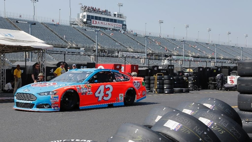 Aric Almirola heads for the track during a NASCAR Sprint Cup auto racing practice session at Darlington Raceway in Darlington, S.C., Friday, Sept. 4, 2015. (AP Photo/Terry Renna)
