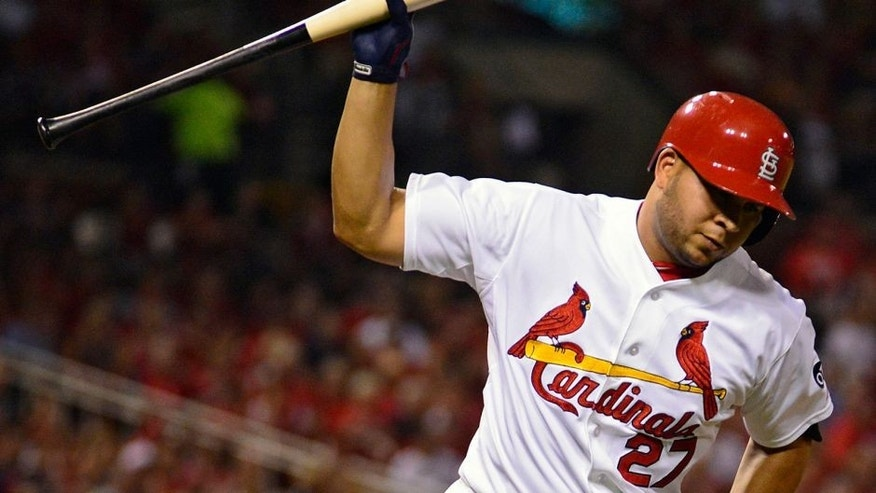 Sep 4, 2015; St. Louis, MO, USA; St. Louis Cardinals shortstop Jhonny Peralta (27) slams his bat after popping out during the first inning against the Pittsburgh Pirates at Busch Stadium. Mandatory Credit: Jeff Curry-USA TODAY Sports