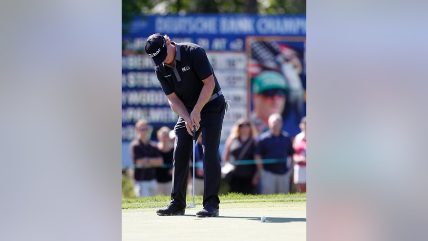 Charley Hoffman putts on the 15th green during the second round of the Deutsche Bank Championship golf tournament in Norton, Mass., Saturday, Sept. 5, 2015. (AP Photo/Stew Milne)