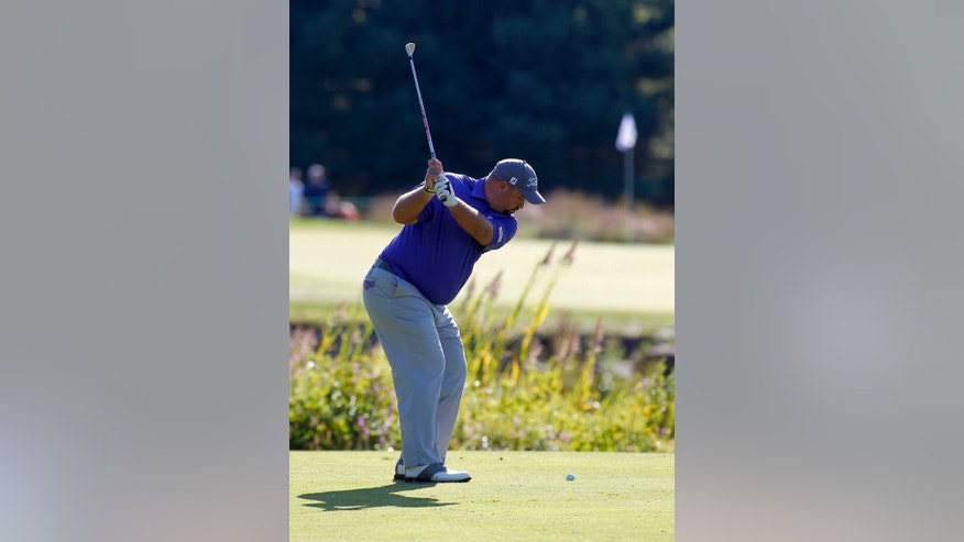 Brendon de Jonge, from Zimbabwe, hits his approach shot to the second green during the second round of the Deutsche Bank Championship golf tournament in Norton, Mass., Saturday, Sept. 5, 2015. (AP Photo/Stew Milne)