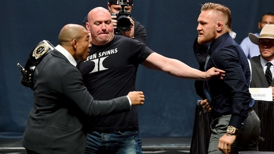 LAS VEGAS, NV - SEPTEMBER 04: (L-R) UFC featherweight champion Jose Aldo and featherweight interim champion Conor McGregor face offduring the UFC's Go Big launch event inside MGM Grand Garden Arena on September 4, 2015 in Las Vegas, Nevada. (Photo by Josh Hedges/Zuffa LLC/Zuffa LLC via Getty Images)