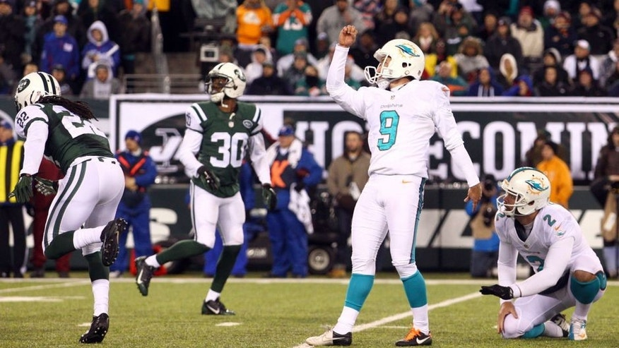 Dec 1, 2014; East Rutherford, NJ, USA; Miami Dolphins kicker Caleb Sturgis (9) kicks a field goal against the New York Jets during the fourth quarter of a game at MetLife Stadium. The Dolphins defeated the Jets 16-13. Mandatory Credit: Brad Penner-USA TODAY Sports