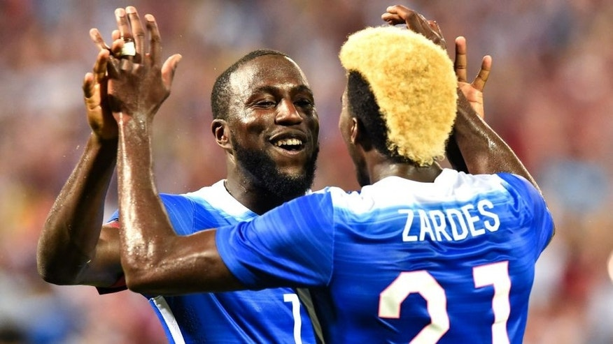 Jozy Altidore (L) of the US celebrates with teammate Gyasi Zardes after scoring his second goal against Peru during an international friendly football match at RFK Stadium in Washington, DC, on September 4, 2015. AFP PHOTO/NICHOLAS KAMM (Photo credit should read NICHOLAS KAMM/AFP/Getty Images)