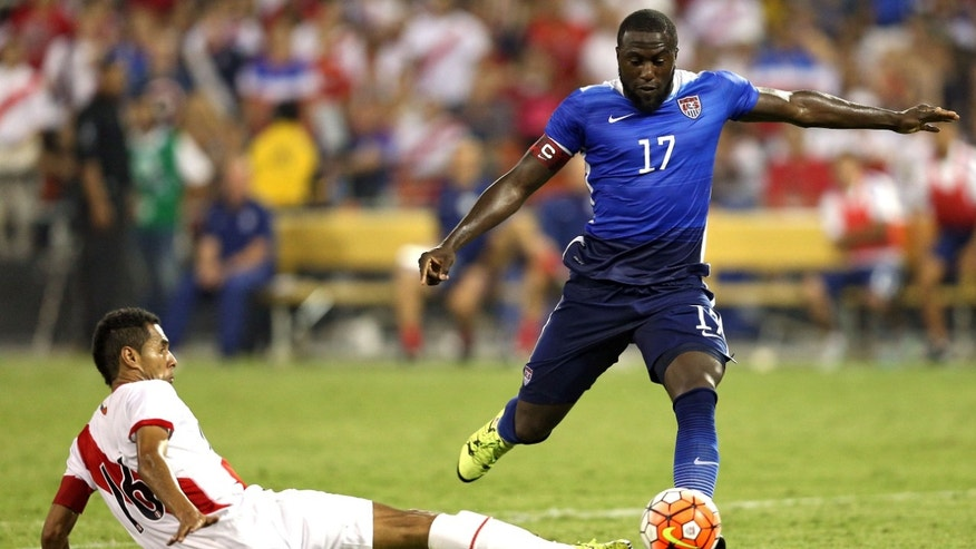 WASHINGTON, DC - SEPTEMBER 04: Jozy Altidore #17 of the United States shoots in front of Carlos Lobaton #16 of Peru in the second half during an international friendly at RFK Stadium on September 4, 2015 in Washington, DC. (Photo by Patrick Smith/Getty Images)