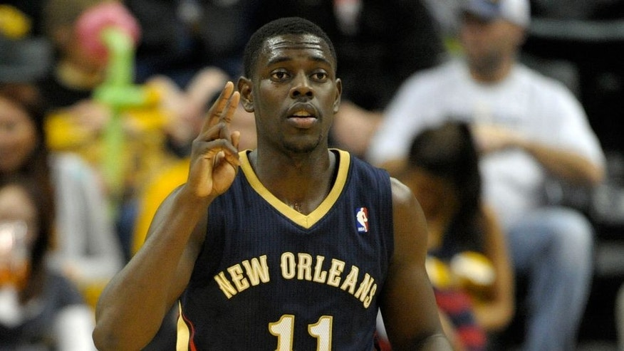 Jan 4, 2014; Indianapolis, IN, USA; New Orleans Pelicans point guard Jrue Holiday (11) signals to his teammates during the second half of the game against the Indiana Pacers at Bankers Life Fieldhouse. Indiana Pacers beat New Orleans Pelicans 99 to 82. Mandatory Credit: Marc Lebryk-USA TODAY Sports