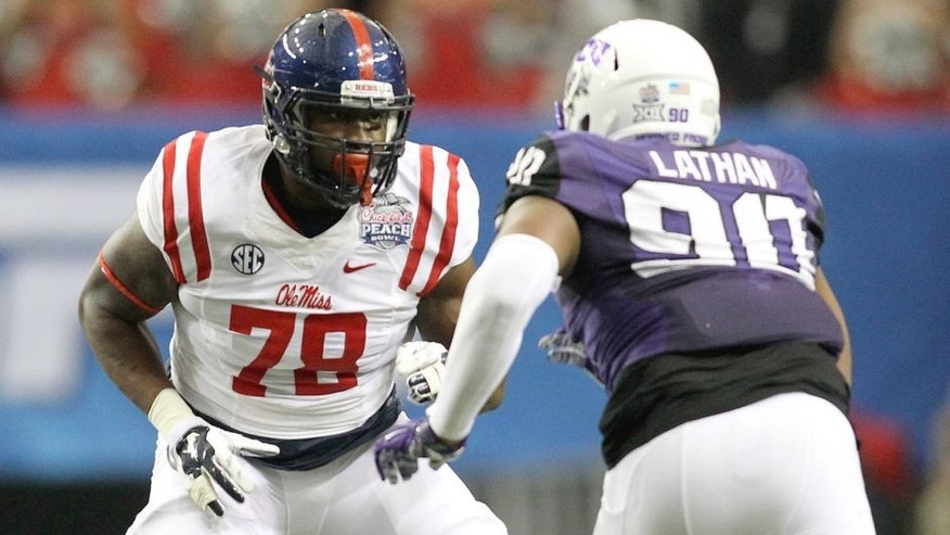 Dec 31, 2014; Atlanta , GA, USA; Mississippi Rebels offensive lineman Laremy Tunsil (78) prepares to block TCU Horned Frogs defensive tackle Terrell Lathan (90) during the first quarter in the 2014 Peach Bowl at the Georgia Dome. Mandatory Credit: Brett Davis-USA TODAY Sports