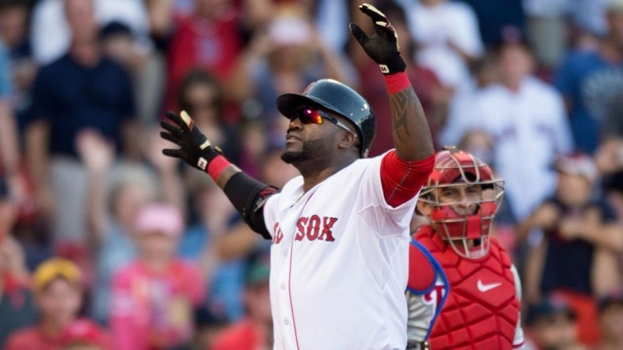 BOSTON, MA - SEPTEMBER 5: David Ortiz #34 of the Boston Red Sox reacts after hitting a home run during the fourth inning against the Philadelphia Phillies at Fenway Park on September 5, 2015 in Boston, Massachusetts. It was career home run number 496 for Ortiz. (Photo by Michael Ivins/Boston Red Sox/Getty Images)