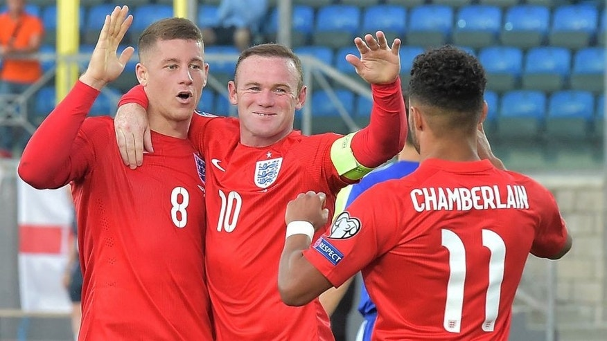 England's midfielder Ross Barkley (L) celebrates with England's forward Wayne Rooney (C) and England's forward Alex Oxlade Chamberlain after scoring during the EURO 2016 qualifying football match San Marino vs England at the San Marino stadium in Serravalle on September 5, 2015. AFP PHOTO / VINCENZO PINTO (Photo credit should read VINCENZO PINTO/AFP/Getty Images)