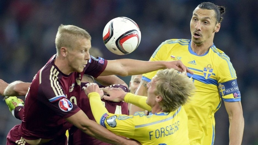 Sweden's forward Zlatan Ibrahimovic (R) and Sweden's midfielder Emil Forsberg (C) fight for the ball with Russia's midfielder Alan Dzagoev (L) during their UEFA Euro 2016 qualifying round Group G football match between Russia and Sweden at Otkrytie Arena in Moscow on September 5, 2015. AFP PHOTO / ALEXANDER NEMENOV (Photo credit should read ALEXANDER NEMENOV/AFP/Getty Images)