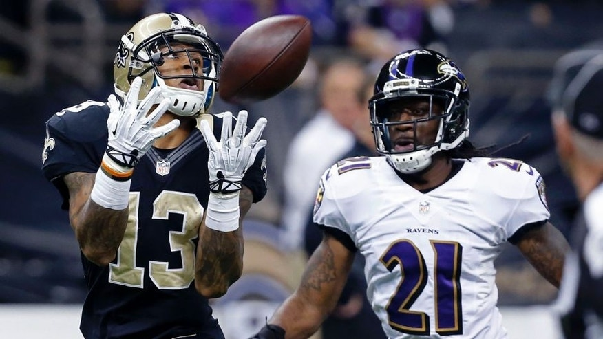 <p>New Orleans Saints wide receiver Joe Morgan (13) pulls in a pass in front of Baltimore Ravens cornerback Lardarius Webb (21) in the first half of an NFL football game in New Orleans, Monday, Nov. 24, 2014. (AP Photo/Jonathan Bachman)</p>