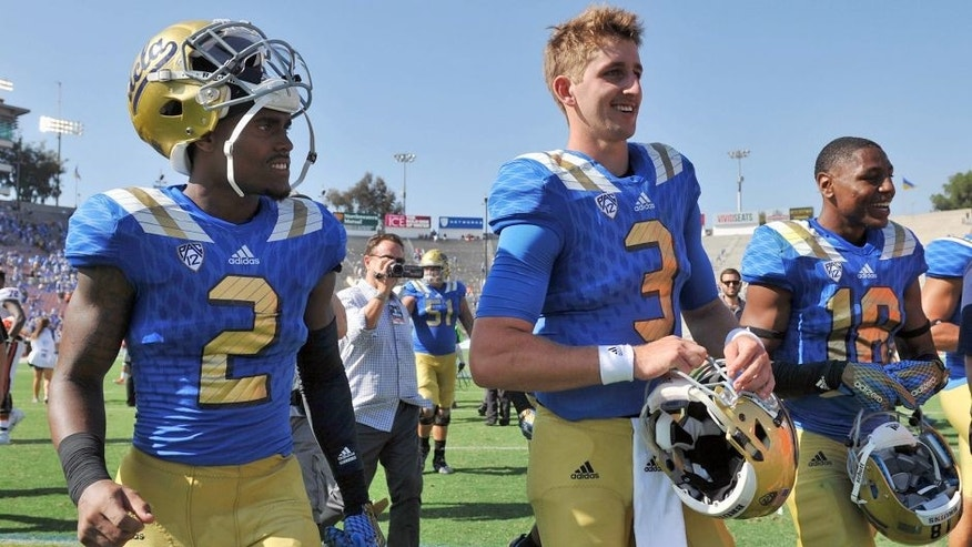 September 5, 2015; Pasadena, CA, USA; UCLA Bruins quarterback Josh Rosen (3), wide receiver Jordan Lasley (2) and defensive back Octavius Spencer (18) following the 34-16 victory against the Virginia Cavaliers at the Rose Bowl. Mandatory Credit: Gary A. Vasquez-USA TODAY Sports