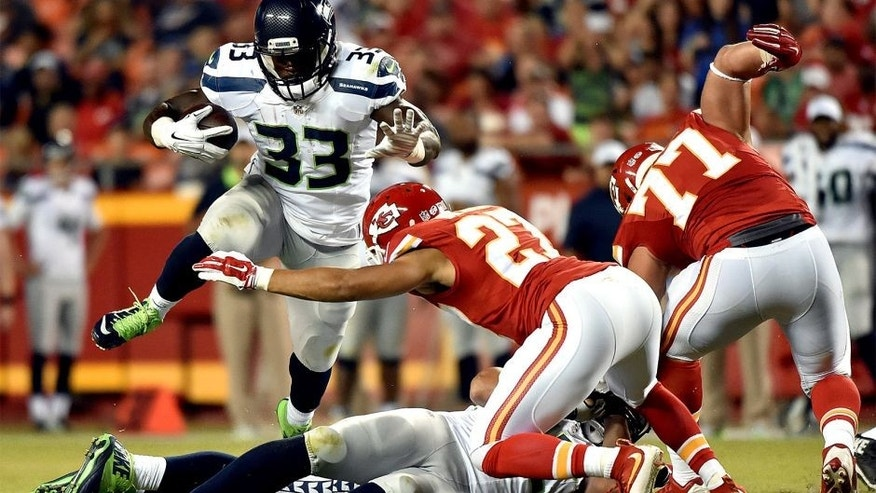 KANSAS CITY, MO - AUGUST 21: Running back Christine Michael #33 of the Seattle Seahawks carries the ball during the preseason game against the Kansas City Chiefs at Arrowhead Stadium on August 21, 2015 in Kansas City, Missouri. (Photo by Peter Aiken/Getty Images)