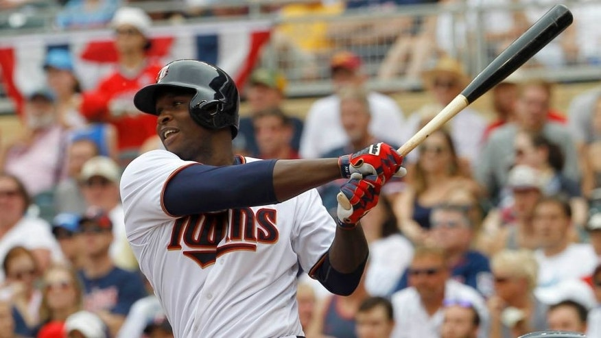 <p>Sunday, July 12: Minnesota Twins designated hitter Miguel Sano watches the flight of his two-run home run off Detroit Tigers starting pitcher Shane Greene during the first inning in Minneapolis. The Twins won 7-1.</p>