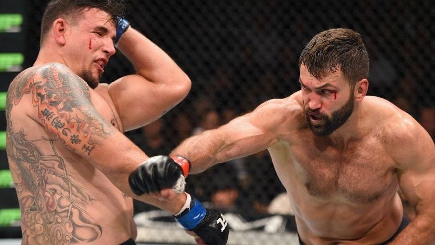LAS VEGAS, NV - SEPTEMBER 05: (R-L) Andrei Arlovski punches Frank Mir in their heavyweight bout during the UFC 191 event inside MGM Grand Garden Arena on September 5, 2015 in Las Vegas, Nevada. (Photo by Josh Hedges/Zuffa LLC/Zuffa LLC via Getty Images)