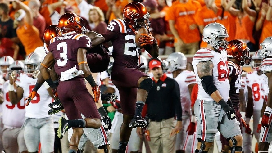 Sep 7, 2015; Blacksburg, VA, USA; Virginia Tech Hokies safety Desmond Frye (26) celebrates his interception during the second quarter against the Ohio State Buckeyes at Lane Stadium. Mandatory Credit: Peter Casey-USA TODAY Sports