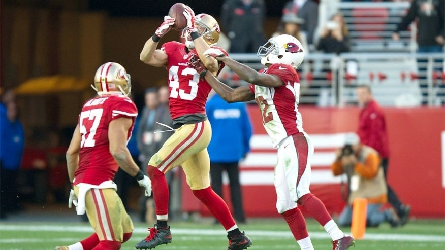 Dec 28, 2014; Santa Clara, CA, USA; San Francisco 49ers strong safety Craig Dahl (43) intercepts the ball from Arizona Cardinals quarterback Ryan Lindley (14, not pictured) during the fourth quarter at Levi's Stadium. The against the San Francisco 49ers defeated the Arizona Cardinals 20-17. Mandatory Credit: Ed Szczepanski-USA TODAY Sports