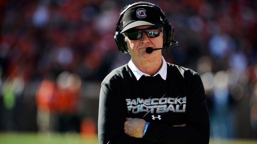 South Carolina head coach Steve Spurrier looks on from the sideline during the first half of an NCAA college football game against Clemson, Saturday, Nov. 29, 2014, in Clemson, S.C. (AP Photo/Rainier Ehrhardt)