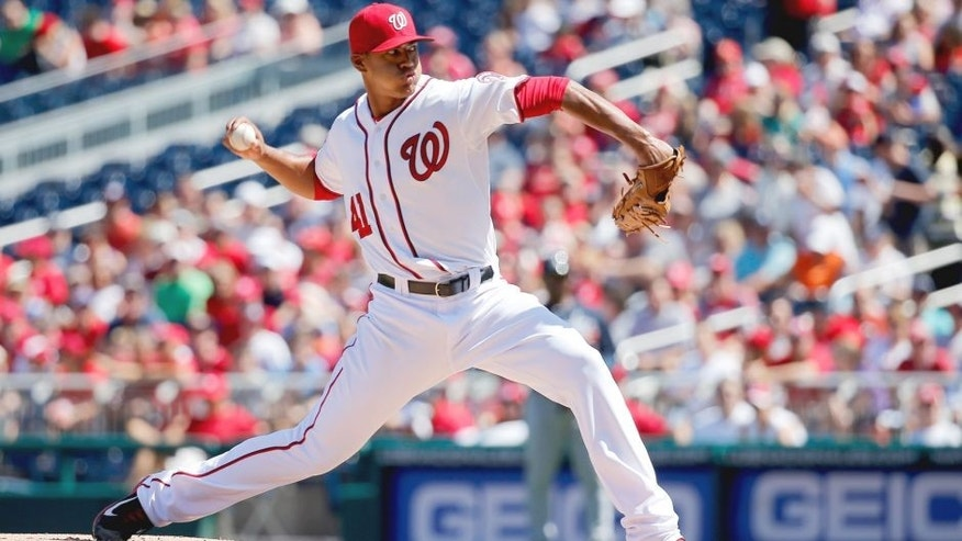WASHINGTON, DC - SEPTEMBER 06: Starting pitcher Joe Ross #41 of the Washington Nationals throws to a Atlanta Braves batter in the first inning at Nationals Park on September 6, 2015 in Washington, DC. (Photo by Rob Carr/Getty Images)