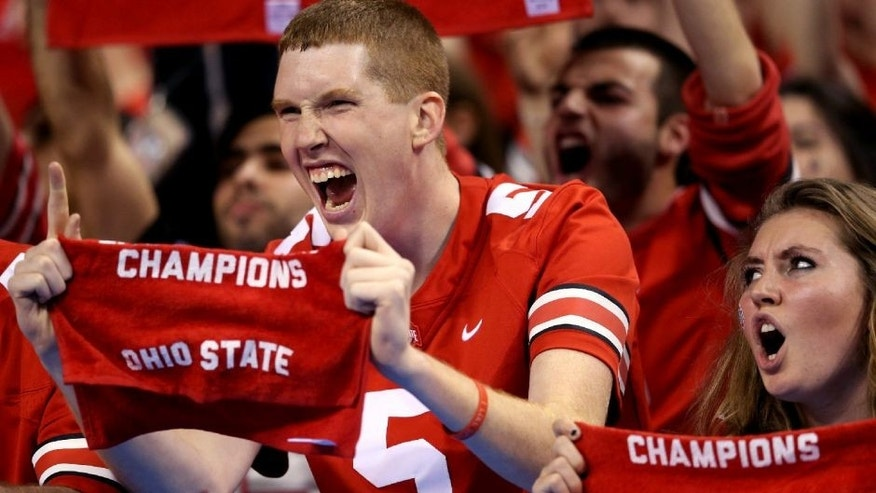 INDIANAPOLIS, IN - DECEMBER 06: Ohio State Buckeyes fans celebrate after their team defeated the Wisconsin Badgers 59-0 in the Big Ten Championship at Lucas Oil Stadium on December 6, 2014 in Indianapolis, Indiana. (Photo by Andy Lyons/Getty Images)