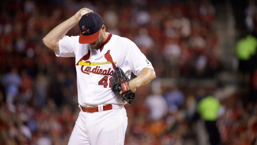St. Louis Cardinals starting pitcher John Lackey pauses on the mound during the fifth inning of a baseball game against the Pittsburgh Pirates, Sunday, Sept. 6, 2015, in St. Louis. (AP Photo/Jeff Roberson)
