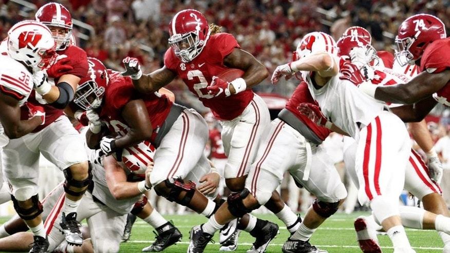 Sep 5, 2015; Arlington, TX, USA; Alabama Crimson Tide running back Derrick Henry (2) scores a touchdown against the Wisconsin Badgers during the third quarter at AT&T Stadium. Mandatory Credit: Tim Heitman-USA TODAY Sports