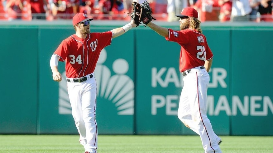 WASHINGTON, DC - AUGUST 24: Bryce Harper #34 of the Washington Nationals celebrates with Jayson Werth #28 after a victory against the San Francisco Giants at Nationals Park on August 24, 2014 in Washington, DC. (Photo by G Fiume/Getty Images)