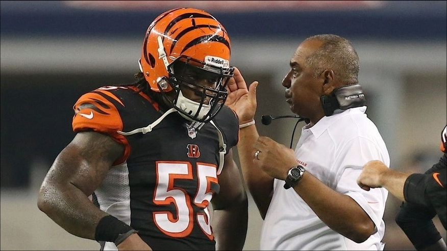 <p>Aug 24, 2013; Arlington, TX, USA; Cincinnati Bengals head coach Marvin Lewis talks with linebacker Vontaze Burfict (55) during a timeout in the second quarter against the Dallas Cowboys at AT&T Stadium. Mandatory Credit: Matthew Emmons-USA TODAY Sports</p>