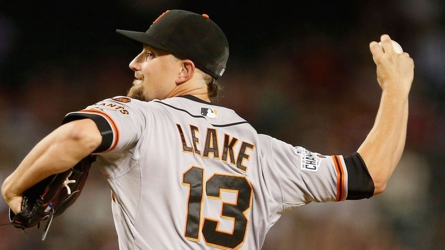 PHOENIX, AZ - SEPTEMBER 07: Starting pitcher Mike Leake #13 of the San Francisco Giants pitches against the Arizona Diamondbacks during the first inning of the MLB game at Chase Field on September 7, 2015 in Phoenix, Arizona. (Photo by Christian Petersen/Getty Images)