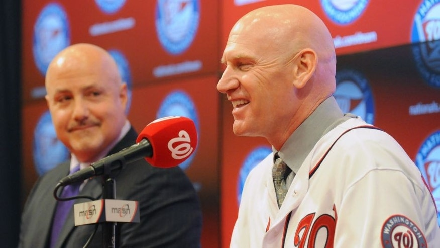 General Manager and President of Baseball Operation Mike Rizzo introduces Matt WIlliams as the Washington Nationals new manager on November 1, 2013 at Nationals Park in Washington, DC. (Photo by Mitchell Layton/Getty Images)