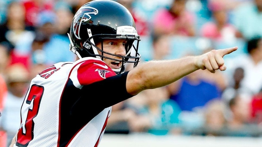 JACKSONVILLE, FL - AUGUST 28: T.J. Yates #13 of the Atlanta Falcons points during the preseason NFL game against the Jacksonville Jaguars at EverBank Field on August 28, 2014 in Jacksonville, Florida. (Photo by Sam Greenwood/Getty Images)