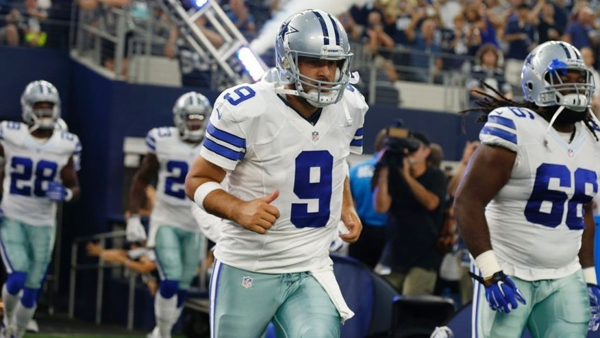 Aug 29, 2015; Arlington, TX, USA; Dallas Cowboys quarterback Tony Romo (9) takes the field prior to the game against the Minnesota Vikings at AT&T Stadium. Mandatory Credit: Matthew Emmons-USA TODAY Sports