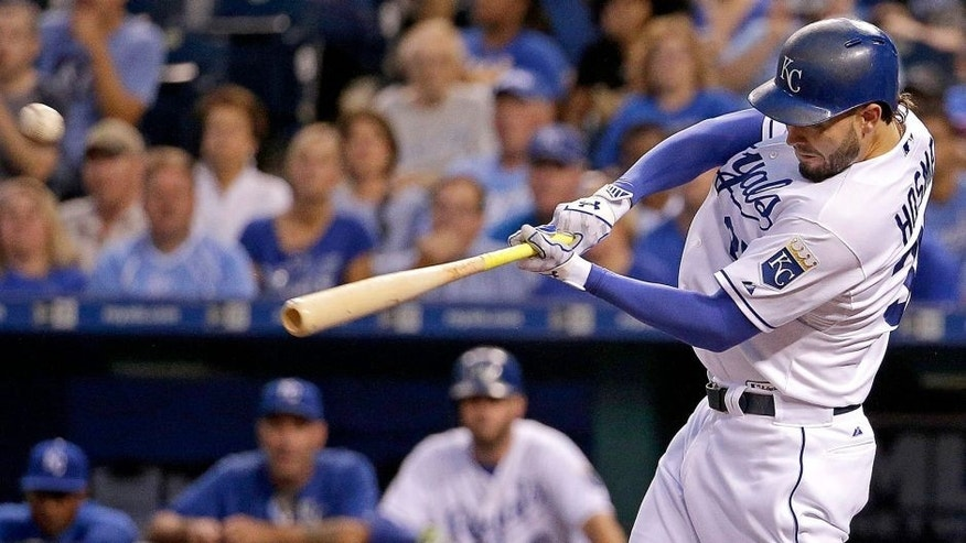 Kansas City Royals' Eric Hosmer hits a three-run double during the first inning of a baseball game against the Minnesota Twins Tuesday, Sept. 8, 2015, in Kansas City, Mo. (AP Photo/Charlie Riedel)