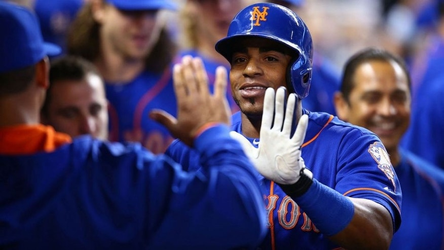 MIAMI, FL - SEPTEMBER 06: Yoenis Cespedes #52 of the New York Mets celebrates with teammates after hitting a solo home run during the first inning of the game against the Miami Marlins at Marlins Park on September 6, 2015 in Miami, Florida. (Photo by Rob Foldy/Getty Images)