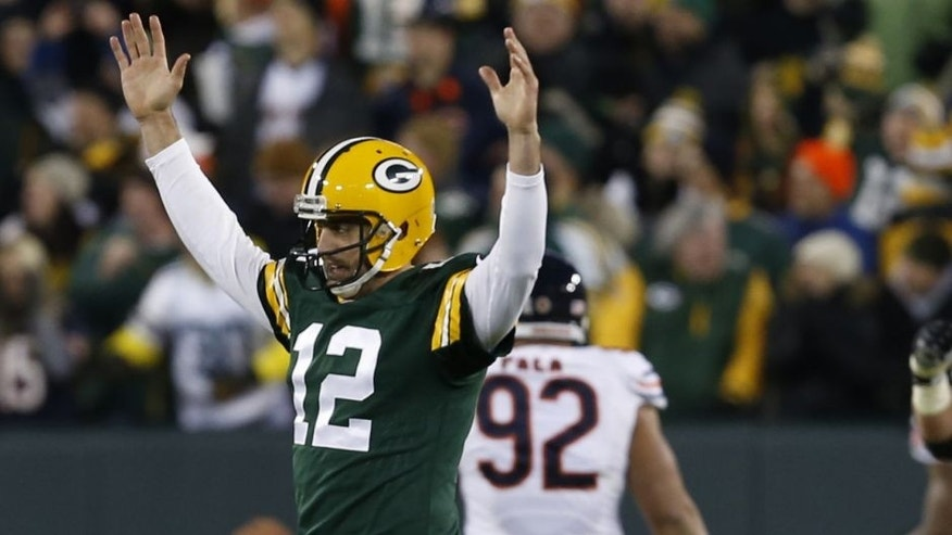 "<p style=""font-family: tahoma, arial, helvetica, sans-serif; font-size: 12px;"">Green Bay Packers quarterback Aaron Rodgers (12) celebrates a touchdown during the first half of an NFL football game against the Chicago Bears Sunday, Nov. 9, 2014, in Green Bay, Wis. (AP Photo/Mike Roemer)</p>"